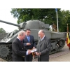 Commemoration Hechtel 2013. Colonel T C S Bonas receiving the Book, now in English, 'Autumn Storm over Hechtel, 6-12 September 1944' from the  author Gerard Wuyts.